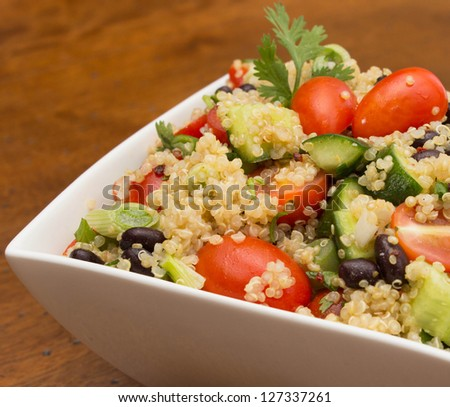 Closeup of healthy quinoa salad with fresh vegetables - stock photo