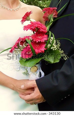 Closeup of heirloom pins on bridal bouquet - stock photo