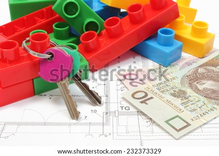 Closeup of home keys, heap of colorful building blocks and banknote lying on construction drawing of house, building blocks for children, housing plan with building blocks, finance concept - stock photo