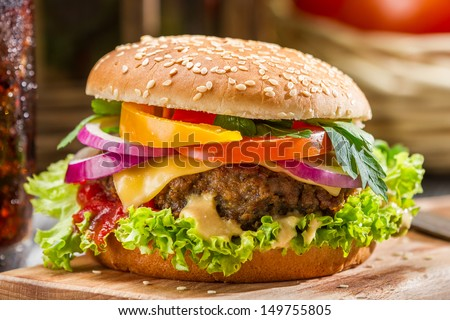 Closeup of homemade hamburger with fresh vegetables - stock photo