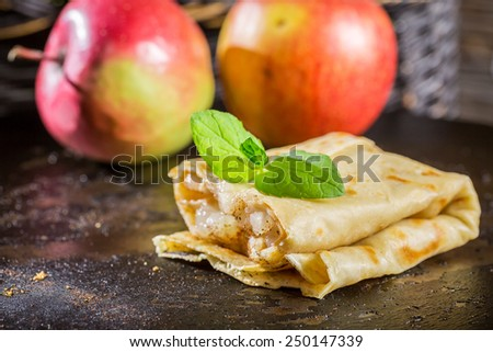 Closeup of homemade pancakes with apples - stock photo