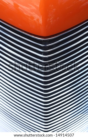 Closeup of hood and Grill of an Orange Custom Hotrod - stock photo