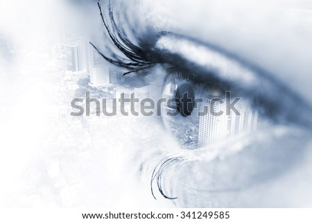 Closeup of human eye with double exposure contemporary city on the background. Horizontal - stock photo