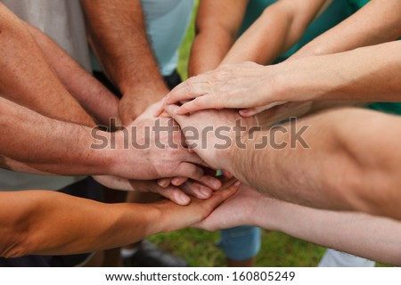 Closeup of human hands showing unity - stock photo