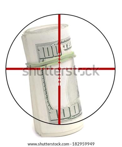 Closeup of hundred dollar bill isolated on white background with crosshairs symbolizing gunning for money - stock photo
