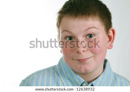closeup of husky boy with freckles smiling - stock photo