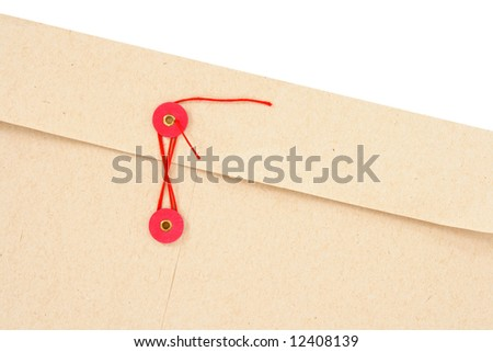 Closeup of interoffice envelope with red clasp. - stock photo