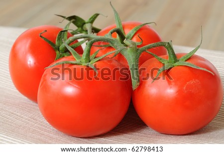 closeup of isolated tomatoes on wood table
