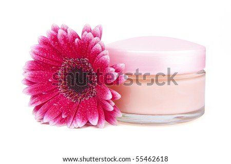Closeup of jar of moisturizing face cream and pink gerbera flower with clipping path - stock photo
