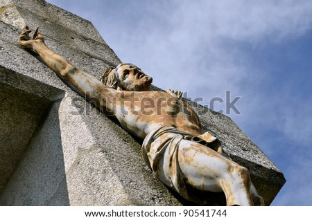 Closeup of Jesus on the stone cross of Salette calvary at Lautrec in southern France. Midi-Pyrénées region, Tarn department - stock photo