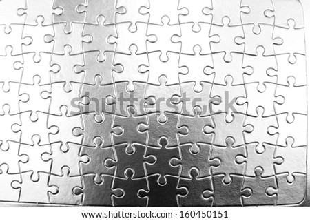 Closeup of jigsaw puzzle pattern - stock photo