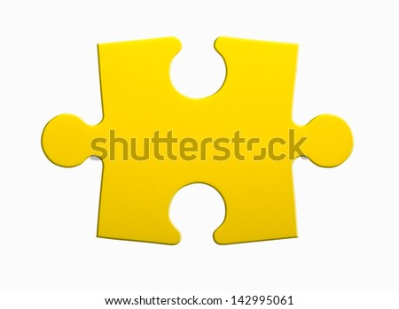 Closeup of jigsaw puzzle piece isolated on white - stock photo