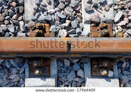 Closeup of joint a rusty railway rail - stock photo