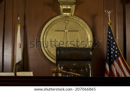 Closeup of judge's seat and gavel in court room - stock photo