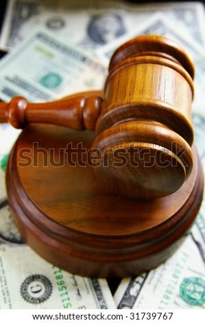 closeup of judges court gavel, over american money - stock photo