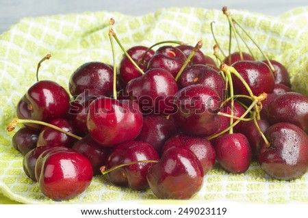 Closeup of juicy, red Lapin Cherries, ripe and ready to eat, on Green Kitchen Towel.  Grown in Hood River, Oregon.  Horizontal