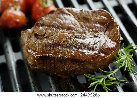 closeup of juicy tenderloin on the grill - stock photo