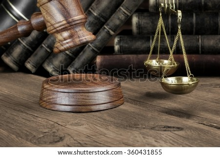 Closeup Of Jydges Gavel, Legal Code, Scales Of Justice On The Rough Wooden Background. Law Concept - stock photo
