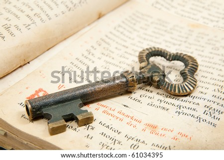 Closeup of key placed on an 18st century vintage book - stock photo