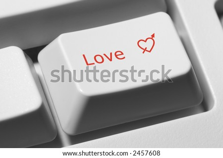 "Closeup of keyboard key with text ""Love"" and red heart - stock photo"