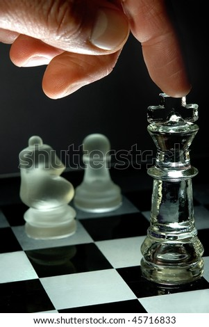 Closeup of king in check. Night time lighting. concept of winning, strategy or planning - stock photo