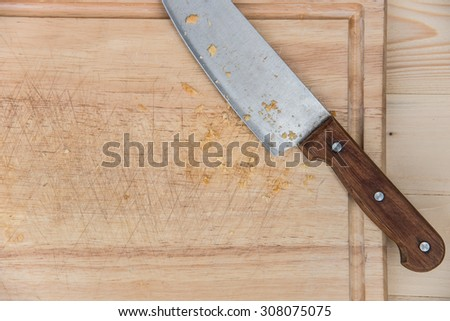 Closeup of Kitchen Knife on a wooden - stock photo