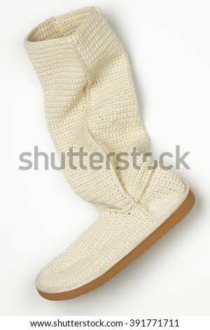 Closeup of knitted boot on white background