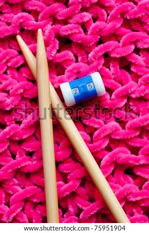 closeup of knitting with bamboo needles and pink wool