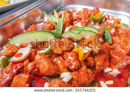 Closeup of Kung Pao Chicken chinese meal on display at a hotel buffet - stock photo