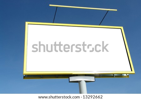Closeup of large blank billboard waiting for advertisement to be added - against clear blue sky - stock photo