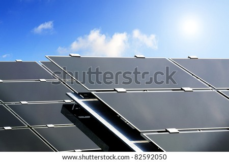 Closeup of large solar panels used to produce electric power from the sun - stock photo
