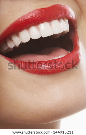 Closeup of laughing woman with red lips - stock photo