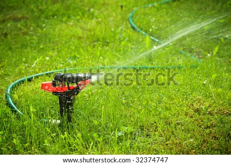 closeup of lawn sprinkler with copyspace