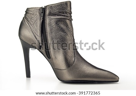 Closeup of leather boot on white background - stock photo