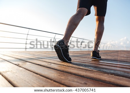 Young beautiful sportive girl training sunrise stock photo for Terrace jogging track