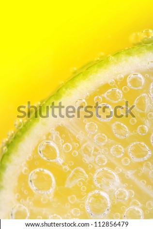 Closeup of lime slice with soda in glass - stock photo