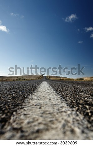 Closeup of Lines on Straight Road - stock photo