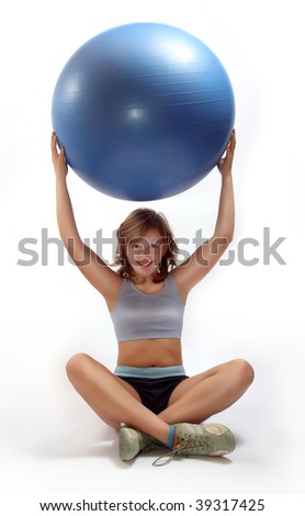 Closeup of little girl exercise with pilates ball - stock photo