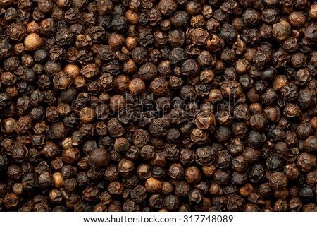 Closeup of lots of dried black peppercorns