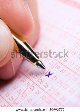 Closeup of lotto slip during the marking of numbers - stock photo