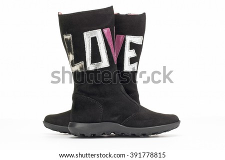 Closeup of love boots on white background - stock photo