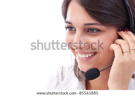 Closeup of lovely young female operator wearing headset