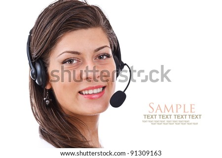 Closeup of lovely young female operator wearing headset - stock photo