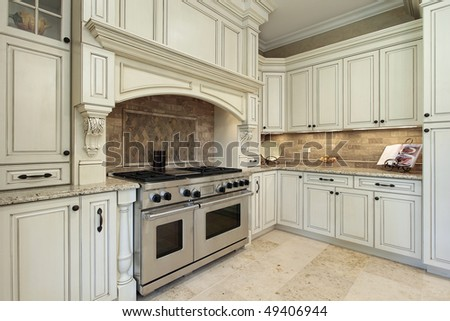Closeup of luxury kitchen with oak wood cabinetry - stock photo