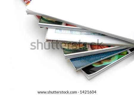 Closeup of magazine stack together (Shallow DOF) - stock photo