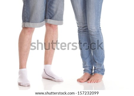 Closeup of male and female legs during a date couple in love standing near