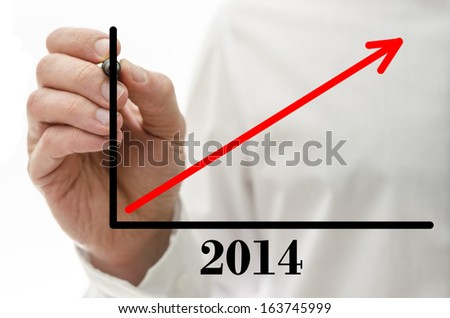Closeup of male hand drawing business success graph on virtual screen. - stock photo