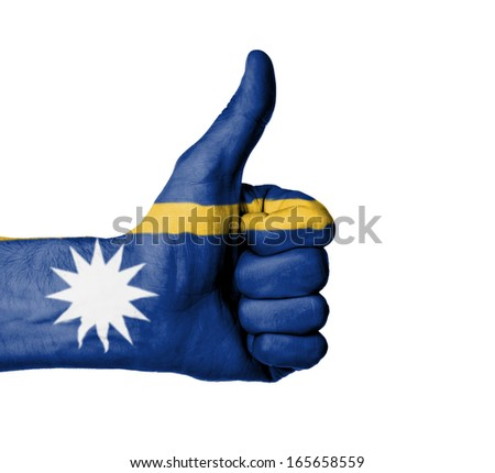 Closeup of male hand showing thumbs up sign, flag of Barbados - stock photo