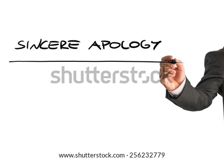 Closeup of male hand writing Sincere apology on white virtual screen. - stock photo