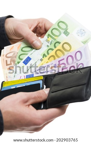 Closeup of male hands pulling out European banknotes from the wallet isolated on white. Shallow depth of field. - stock photo